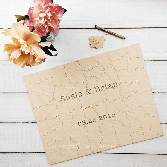 Customized wood wedding guest book puzzle. Nice for rustic yet chic wedding reception.