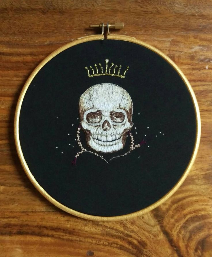 Skull with crown and flowers. Unique hand embroidery
