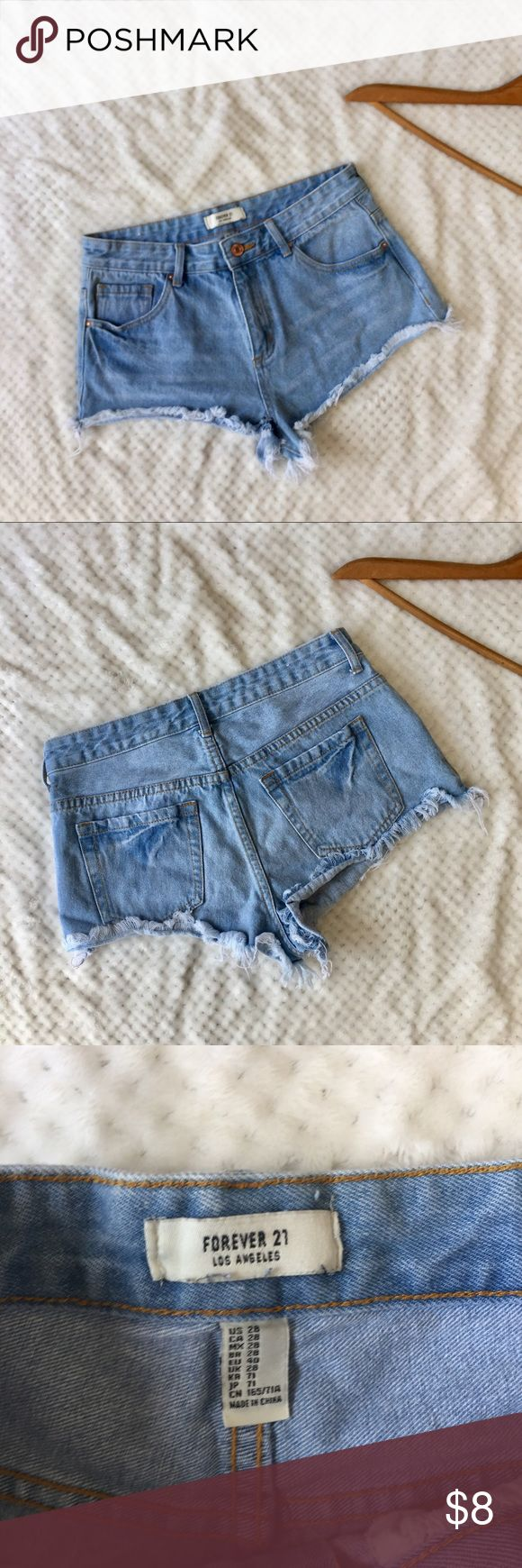 """Forever 21 Light Washed Denim Cutoffs Size 28 F21 LIGHT WASHED DENIM CUTOFF SHORTS  SIZE 28  MEASUREMENTS :  WAIST : 14"""" RISE 6"""" Forever 21 Shorts Jean Shorts"""