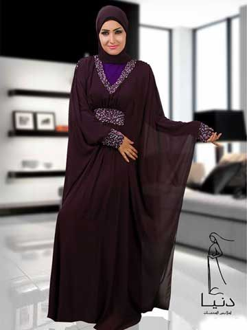 """Solyama Butterfly Abaya Butterfly style abaya made of two layers, bottom layer is a separate Lycra lining, top is made of Chifffon. Top layer is decorated by beads under bust line around, collar and cuffs.Underneath the Chiffon layer there is a ribbon to tighten abaya under bust line.  Fabric: Chiffon and Lycra Washing Instructions: Machine Wash Tailored and designed by """" Donia Abayas by Donia hand beaded, never two abayas are exactly identical"""