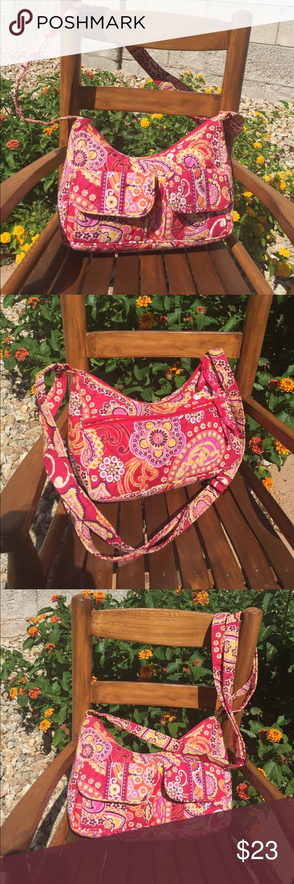 VERA BRADLEY HANDBAG The Cutest VERA BRADLEY HANDBAG WITH  ADJUSTABLE STRAPS  TO CROSS-BODY,  Pattern and Colors add to Great Look! Has two Front  Pockets with Snaps. Out side back large zip Up Pockets.  Inside had Three open pockets . A Perfect size not to big easy take along light weight. Measurements  about 11 by 7 inches.  A matching wristlets also available.  Final Price $23.00 BUNDLE And SAVE 15% Contact me if you have any questions:) Vera Bradley Bags Crossbody Bags