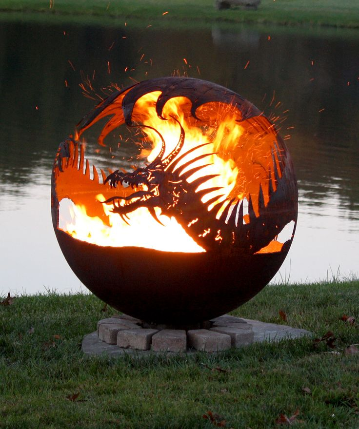 Pendragon's Hearth-Dragon Fire Pit Sphere by artist Melissa Crisp. It's powerful, encompassing wings surround the fire and every wicked detail comes alive.