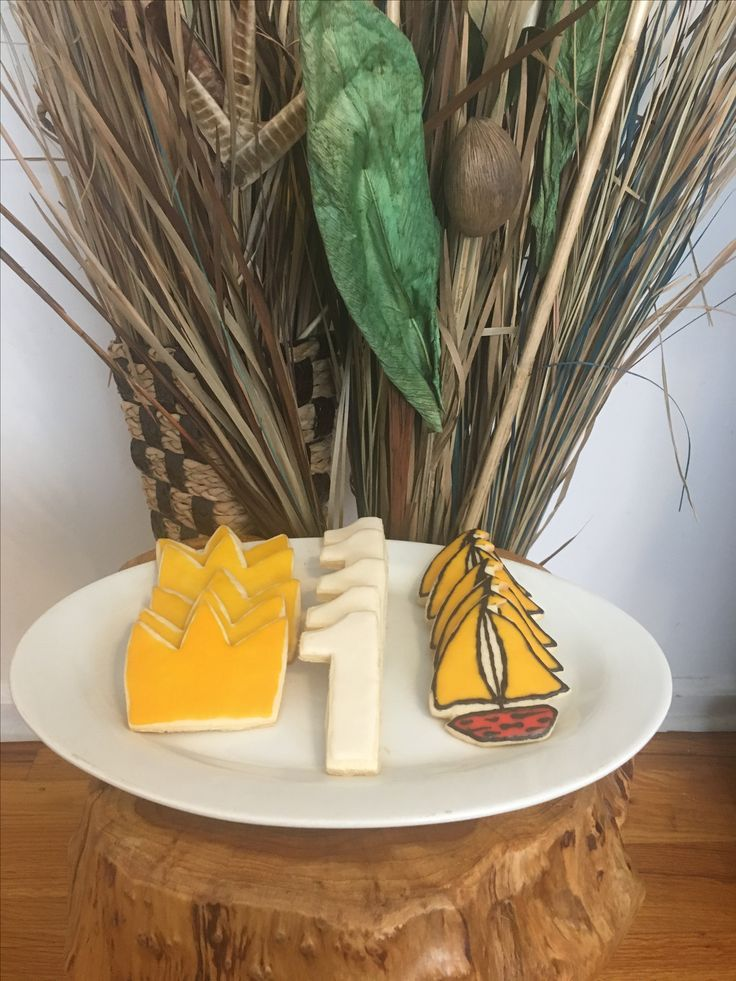 Where the wild things are themed cookies for a 1st birthday party. #wherethewildthingsare #theme #1stbirthday #party #wildone #sugarcookies #icing #red #black #yellow #white #one #king #crown #sailboat #cookiecutters #rustic #string #wrapped #cellobags #favors #homemade #diy #custom #dessert