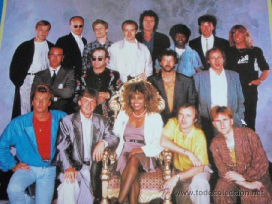 Prince's Trust Concert Line-Up 1985. bottom row: Rod Stewart, Paul McCartney, Tina Turner, Phil Collins.?  - Middle: ?, Elton John, Eric Clapton, ? Back: several members of the artists bands, and Paul Young