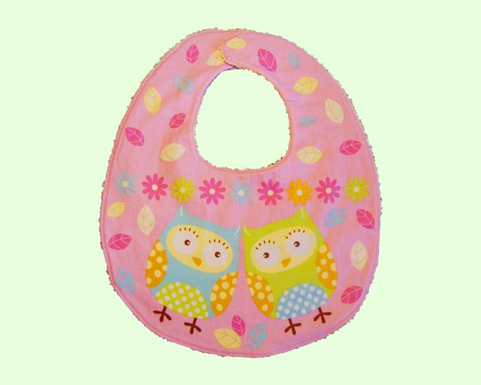 This beautiful baby bib is perfect for you baby girl with a Daisy Owl print on the front and a soft towel material on the back, perfect for feeding.