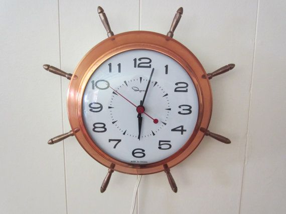 I saw a version of these Ingraham clock's in everyone's kitchen growing up.  $39 CAD. Find it in Etsy shop FlashbackFinds.