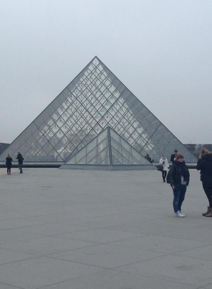 The Louvre Pyramid (Pyramide du Louvre) is a large glass and metal pyramid designed by Chinese American architect I.M. Pei, surrounded by three smaller pyramids, in the main courtyard (Cour Napoléon) of the Louvre Palace (Palais du Louvre) in Paris. The large pyramid serves as the main entrance to the Louvre Museum. Completed in 1989, it has become a landmark of the city of Paris.