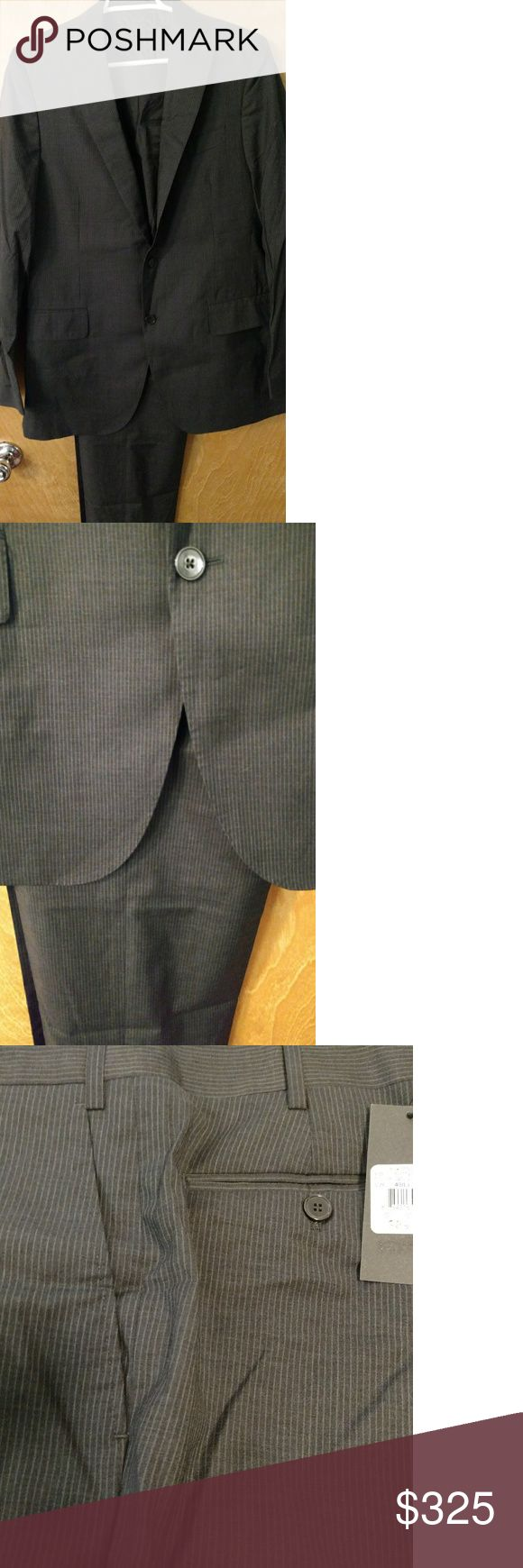 Men's pinstripe suit 40L Gorgeous men's suit from Bloomingdale's. Black pinstripe, unhemmed and never worn. Retail price $895! Bloomingdale's Suits & Blazers Suits