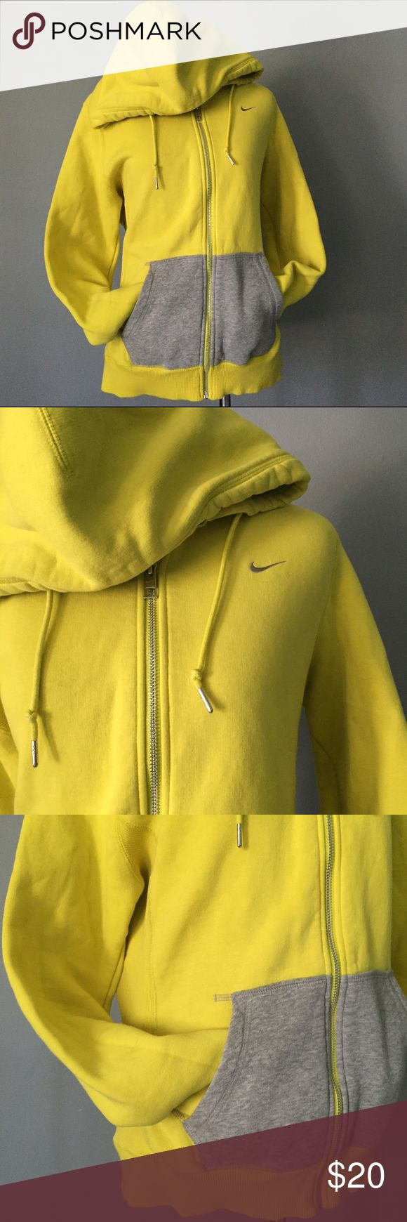 Yellow Nike Zip Hoodie This listing is for a large yellow Nike zip hoodie. It's great for running in the morning or any activity you want to complete throughout the day. Size is a large. Nike Tops Sweatshirts & Hoodies