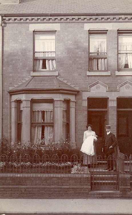 The Victorians outside their Victorian home.