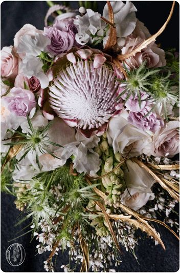 Lightly gilded gold greenery Soft pink king protea for unexpected texture.  Holly-Hedge-Estate-Unusual-Feminine-Lingerie-Inspired-Neutral-Ivory-White-Blush-Metallic-Lace-Protea-Garden-Rose-Thistle-Tuberose-Bridal-Bouquet-Oleander-New-Jersey-Bucks-County-Wedding-Florist-Floral-Design