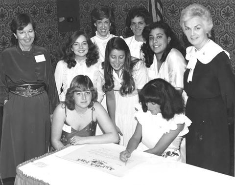 1982 when Zeta Pi (CWRU Alpha Phi) was installed at Case Western Reserve University. They are signing  Zeta Pi's official charter.