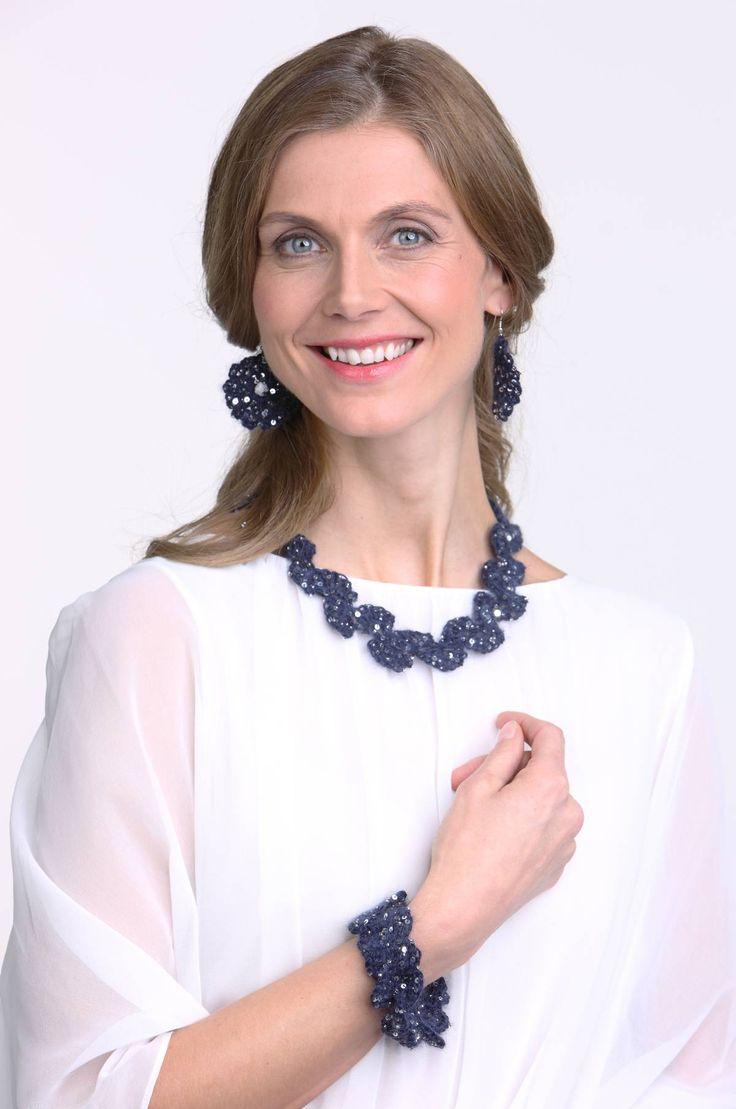 Crochet neckless, earrings and bracelet. Yarn: Artyarns Beaded Mohair & Sequins. Published in Familien no. 1/2015.