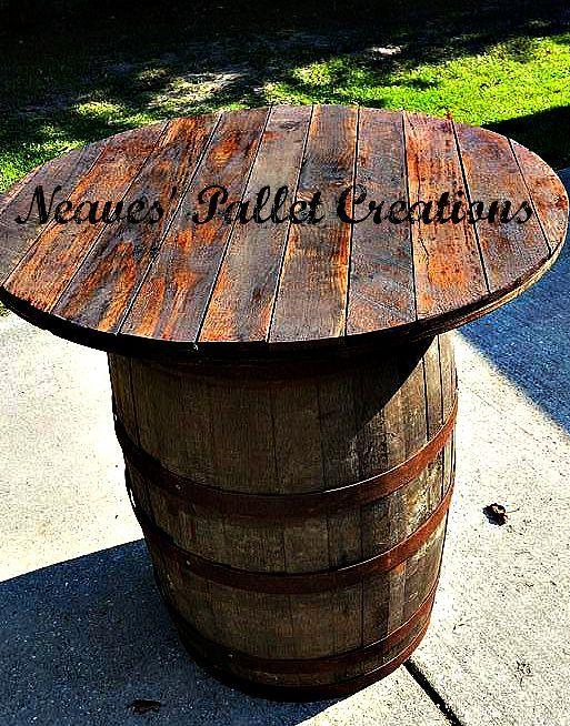 """RECYCLED WOOD PALLETS: Does this say """"Man Cave"""" to anyone else? We took an old Whiskey Barrel and topped it with oak planks from a pallet. It is stained and we are selling it for $175. It is 36"""" high and 36"""" in diameter. We can make stools to complete the set if you ask. Message us if you are interested in this indoor/outdoor, rustic, poker-playing, beer guzzling, crawfish eating table! (We only have two of these.) Item # 636"""