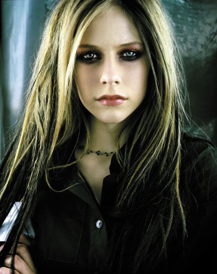 Avril Lavigne... lol... I cannot count the # of times I have been told I look like her. I just did the dark streaky/underneath thing last week, too... gah lol!