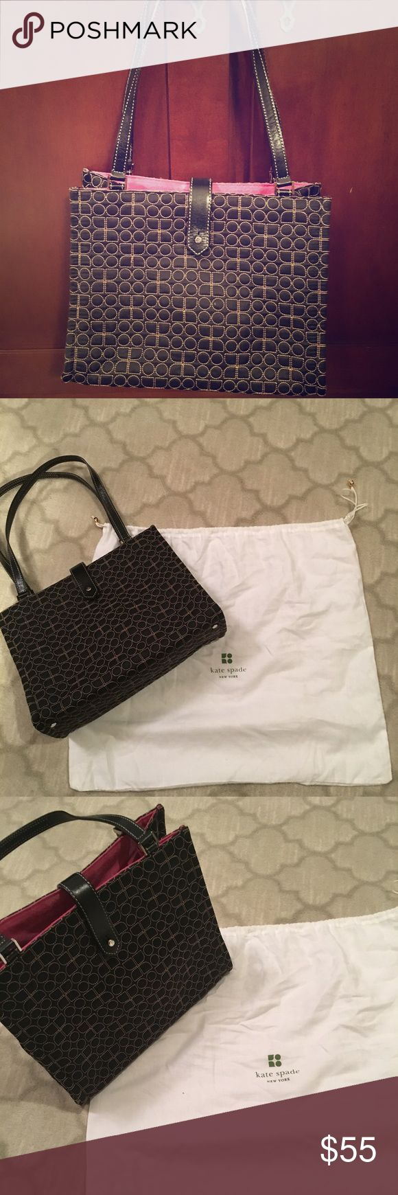 Kate Spade Noel Dot Signature Shoulder Bag Kate Spade Noel Dot Signature Shoulder Bag that is black and white on the exterior and has a pink lining. Features button enclosure, protective metal feet, and interior pockets. This is an excellent neutral piece for your collection that is a great everyday shoulder bag! In like new condition. kate spade Bags Shoulder Bags