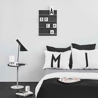 A personal bedroom with personal pillow cases. And Paper Shelf with AJ Vintage ABC porcelain collection. Table to Go serves perfectly well as bedside table.