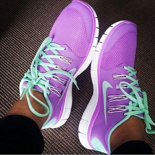 Aqua purple Nike shoes.