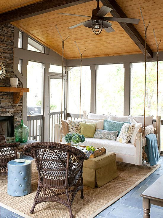 A swing bed is a unique piece of furniture that adds character and seating to a porch. To ensure safety, these beds are best hung by a licensed contractor. Here, a normal twin-size mattress was used for the bed. Add lots of decorative pillows to bring color and pattern to the space.