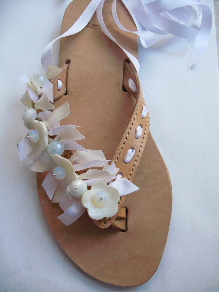 Bridal leather flipflops decorated with ribbon, crystals, moon beads, and ivory flowers.