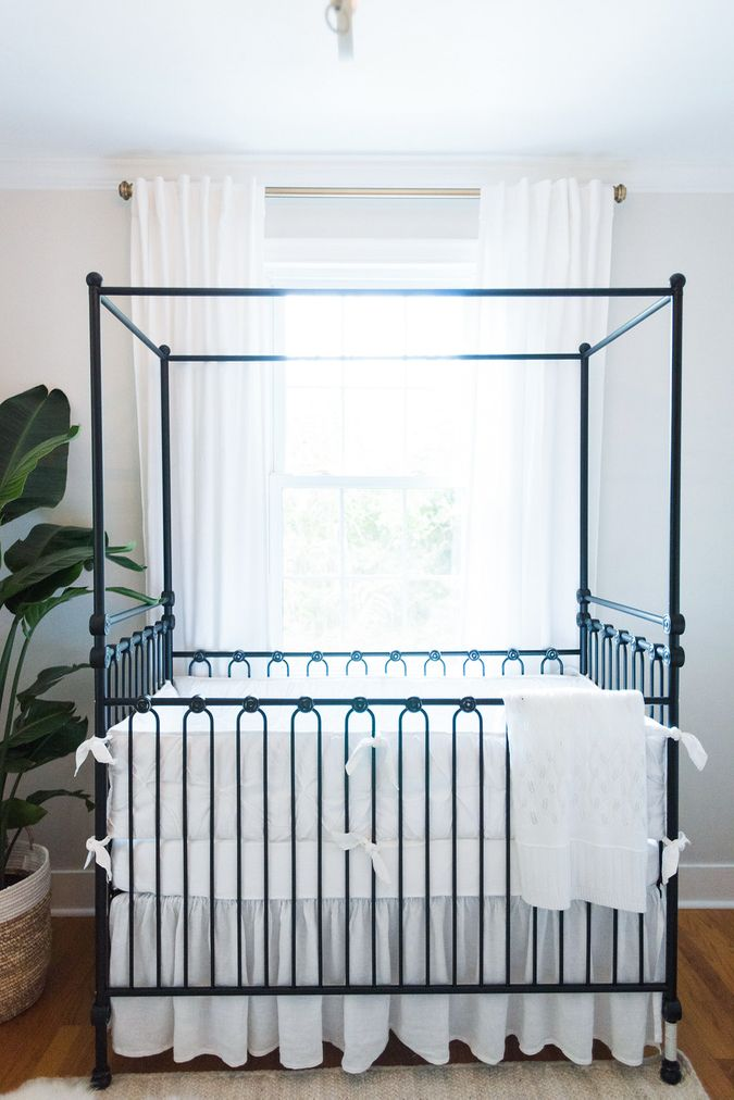 Neutral Baby Nursery with Black Iron Canopy Crib