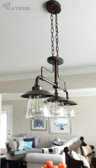Trio of industrial lights from @Lowe's over this wooden dining room table.