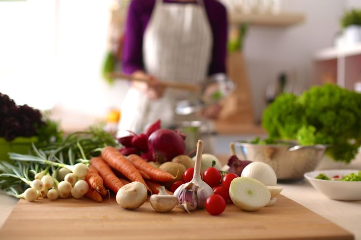 Young Woman Cooking in the kitchen. Healthy Food