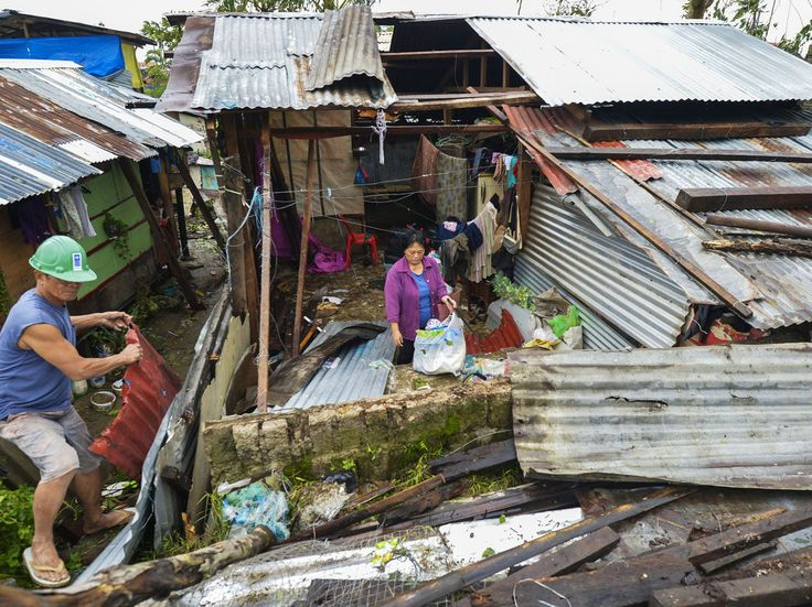 A house is left roofless due to strong winds brought by powerful Typhoon Hagupit in Tacloban City on the Philippine island of Leyte on Sunday.