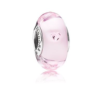 The innovative use of heart-shaped sparkling stones and authentic Murano glass, creates an unique charm. The glass design in soft romantic pink is handmade by skilled craftsmen - no two charms are exactly alike. #PANDORA #PANDORAcharm
