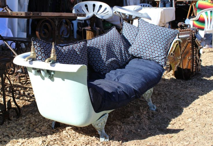 A bathtub converted into a sofa was on display at the Village Green
