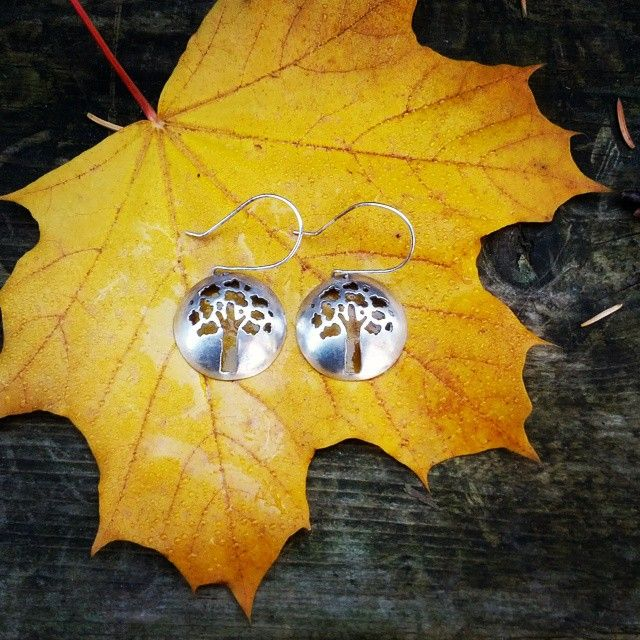 This strong oak tree silhouette reminds me of picnics in the park on a hot summer evening, or reading a book in the shade in the fall. These earrings are 100% handmade from sterling silver. #slashpiledesigns