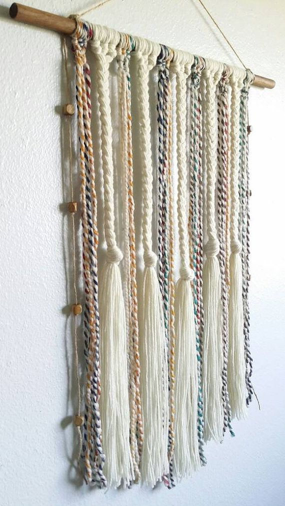 this a yarn wall hanging in cream with multi color accents on wall hangings id=55821