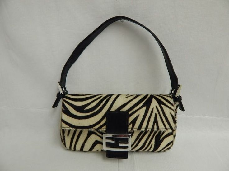 Fendi Black & White Zebra Print Calf Hair Black Leather Handbag.  Okay, so my thrift store find isn't a Fendi, but this is the closest I can find. This particular purse has an opening bid of $60, though other prices online are much higher. I paid $6 for a similar, genuine calf hair (but not couture) purse.