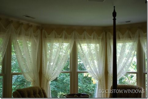 Creative way to hang curtains in a bay window curtains for Unusual ways to hang curtains