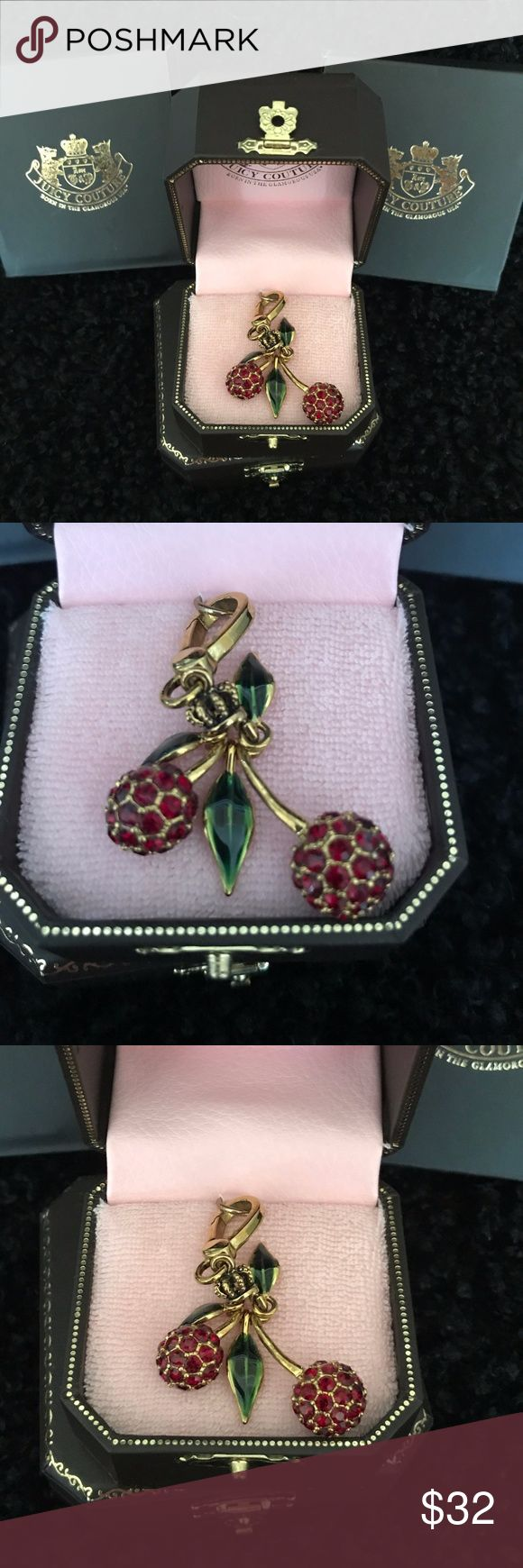 JUICY COUTURE Red Rhinestone Cherries Charm JUICY COUTURE Rhinestone and Enamel Cherries Charm.  ...Retired piece by Juicy ...Done in brilliant Red  Rhinestones ...Green enameled leaves ...Gold tone metal ...completely jointed Juicy Couture Jewelry Bracelets
