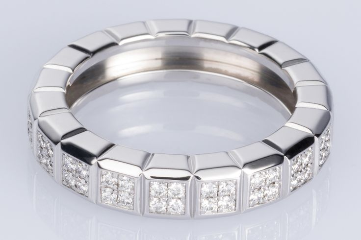Chopard Ice-Cube Collection. Brilliant cut white diamonds set in fours in each cube - 18k white gold. Makes a gorgeous wedding band or eternity ring. Available on www.1stdibs.com - The Jewellery Trading Company