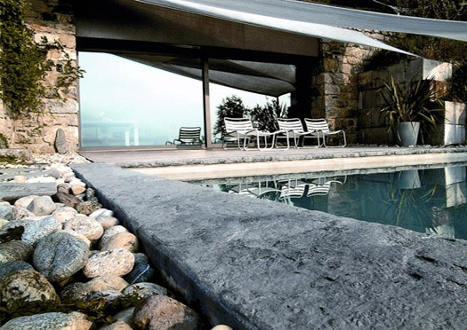 Rectangular pool with natural stone edging.