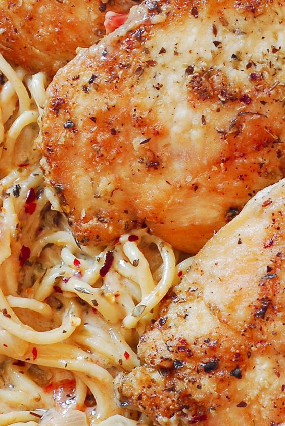 Chicken Pasta in Creamy White Wine Parmesan Cheese Sauce. Italian seasoning, white wine and Parmesan cheese come together as one to flavor chicken and pasta. With only 30 minutes of total work, it's simple, fast and delicious!