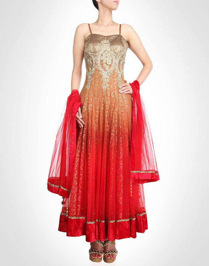 This tremendously elegant red and orange ombre tone net anarkali surfaced on floral gold lace backdrop.SHOP NOW@ www.kimaya.in