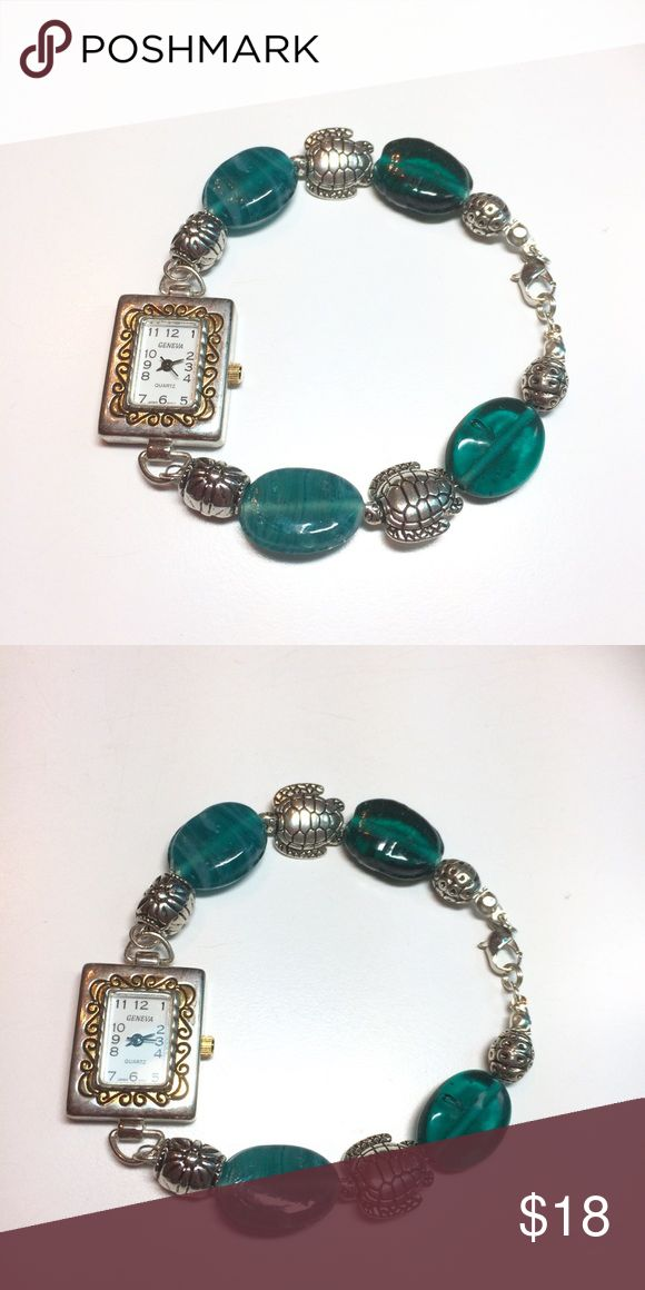 Ladies handcrafted Beaded turtle charm watch new This brand new handcrafted watch has Aqua glass beads, silver turtle charms and a lobster claw clasp. Measures approx 7 1/2 inches long. handmade Accessories Watches