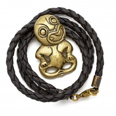 Necklace Brass Tiki. This hand crafted Tiki is cast in brass and looks great on the plaited black cord with spring hook attachment. Each one is individually poured and finished. The meaning of the Tiki is often linked with creation and fertility. Traditionally Tiki were carved from Greenstone or occasionally bone. Made in New Zealand.   See more at www.entirelynz.co.nz/gifts