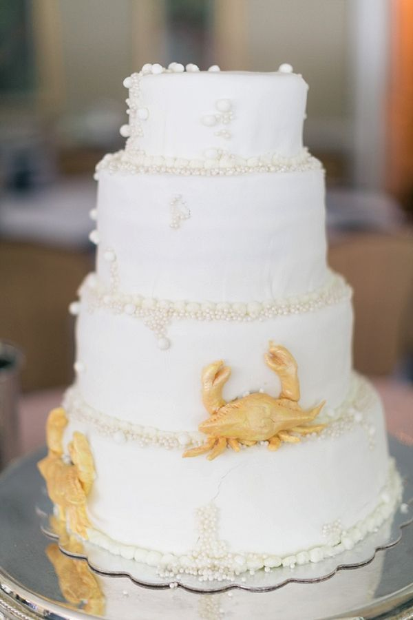 Gorgeous nautical wedding cake with golden crabs