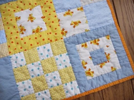Random blocks combined to make a baby quilt. Cute idea!