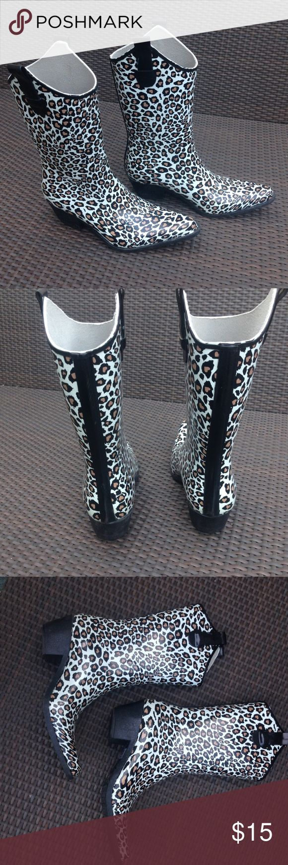 Daily Shoes Leopard Cowboy Rain Boot Daily Shoes Cowboy Tight Leopard Print Rain Boots. Size 9. All rubber rain boots.  Slip on.  Mid knee length.  Thick rubber heel.  Man made material. EUC excellent used condition. daily shoes Shoes Winter & Rain Boots