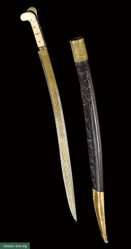 ottoman subjugation 18th and early 19th A large ottoman silver dagger (jambiyya) turkey or the balkans, late 18th/early 19th century the tapering double-edged blade curving upward, each face with central ridge, the forte with gold overlaid decoration, the silver hilt and scabbard with fine repoussé rocaille decoration, the scabbard with silver filigree.