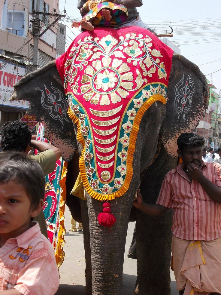 painted elephant Festival India. Three men accompanied the elephant – two on foot and one riding.