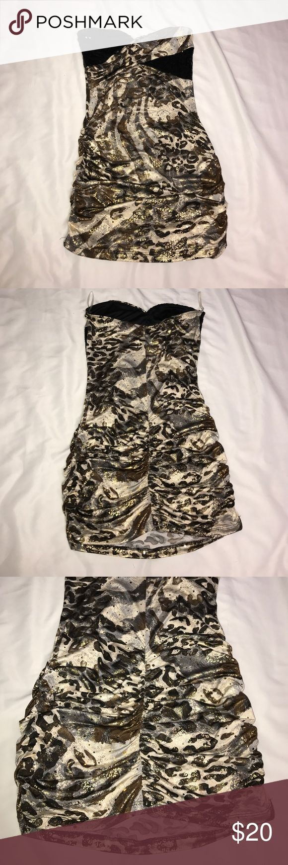 Strapless Sequined Multi Pattern Bodycon Dress Great for a night out or a homecoming! Different animal prints with sequins and shimmer. Very comfortable! The sides and back are ruched for a stunning fit. Size medium but I usually wear a size small and only wore this once. Carolina USA Dresses Mini