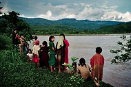 "NYTimes ""Ashaninka children watching the Ene River in front of their village of Boca Sanibeni, in an area that would be flooded by a dam."" Pakitzapango hydroelectric dam"
