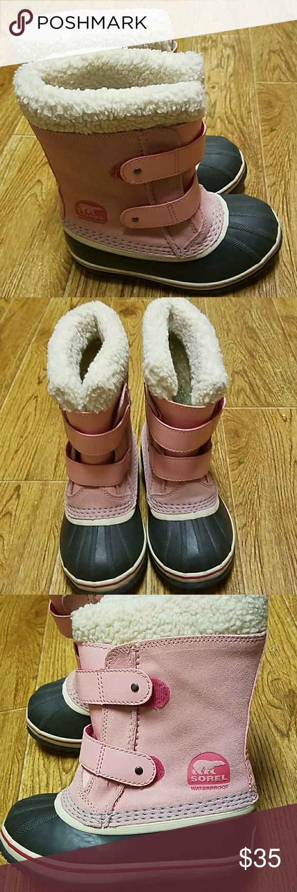 Little girls pink Sorel snow boots Super cute little girls pink SOREL 1964 PAC strap snow boots. Pre-loved. Still in good shape!!.  Waterproof. Little girls/ children's size 12.  See last pic of size chart and stock photo. Double velcro straps. Faux fur lining.  Smoke free home. Sorel Shoes Rain & Snow Boots
