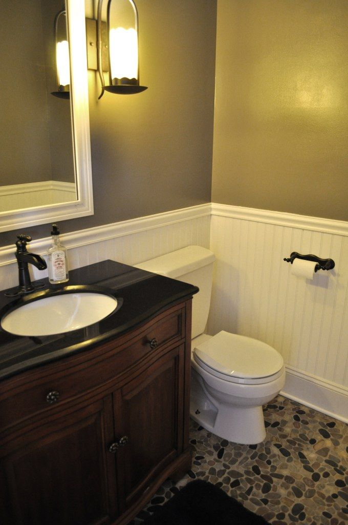 bead board wall part way up, stone look floor lighter paint color and vanity